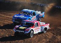 Dec. 9, 2011; Chandler, AZ, USA;  LOORRS pro 2 unlimited driver Rodrigo Ampudia (36) and Robby Woods (99) during qualifying for round 15 at Firebird International Raceway. Mandatory Credit: Mark J. Rebilas-