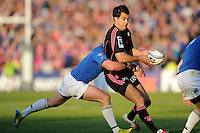 Jérôme Porical of Stade Francais is tackled by Ian Madigan of Leinster  during the Amlin Challenge Cup Final between Leinster Rugby and Stade Francais at the RDS Arena, Dublin on Friday 17th May 2013 (Photo by Rob Munro).