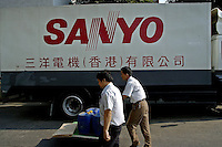 Staff passing truck marked with company brand name, at a Japanese Sanyo consumer electronics goods factory in Shenzhen, China..04 Nov 2004