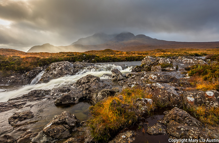 Isle of Skye, Scotland: Rushing waters of the River Sligachan and breaking light on the Black Cuillin Mountains in the distance.