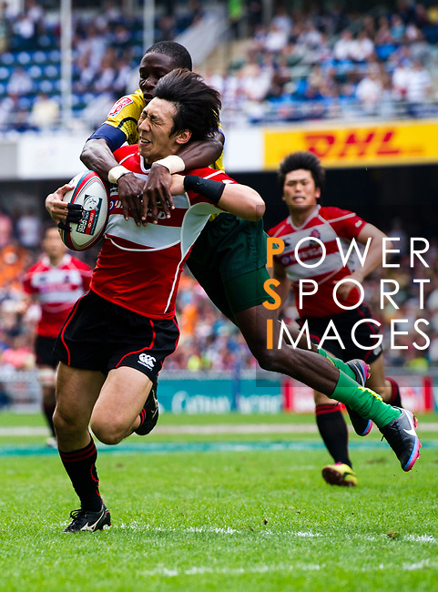 Japan play Jamaica on Day 2 of the Cathay Pacific / HSBC Hong Kong Sevens 2013 on 23 March 2013 at Hong Kong Stadium, Hong Kong. Photo by Manuel Queimadelos / The Power of Sport Images