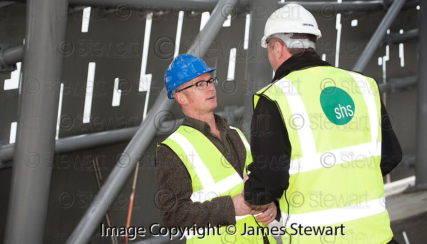 Sculptor Andy Scott discusses the progress of The Kelpie construction with Dave Perry, Contracts Manager Shs Construction, during a visit to the Helix site.