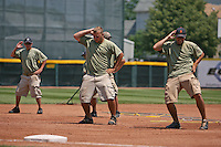 June 24, 2009:  The dancing grounds crew put on a show to the tune of Vanilla Ice during the third inning of a game at Jerry Uht Park in Erie, PA.  Photo by:  Mike Janes/Four Seam Images