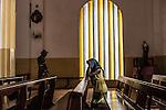 CAR, Bangui: A christian woman is praying in the cathedrale of Bangui. 22th April 2016. <br /> <br /> RCA, Bangui : Une femme chrétienne est en train de prier dans la cathédrale de Bangui . 22 Avril 2016.