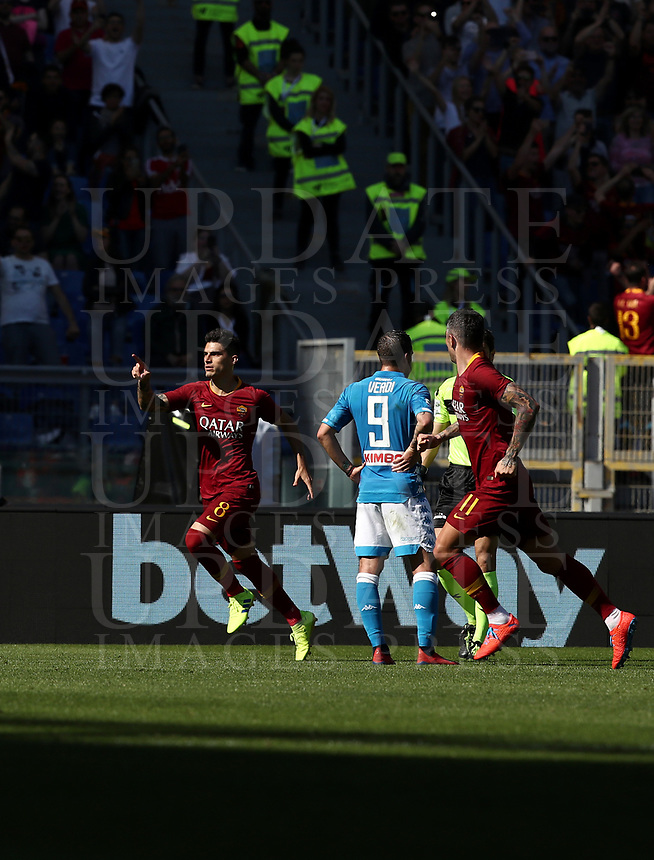 Football, Serie A: AS Roma - SSC Napoli, Olympic stadium, Rome, March 31, 2019. <br /> Roma's Diego Perotti (l) celebrates after scoring during the Italian Serie A football match between Roma and Napoli at Olympic stadium in Rome, on March 31, 2019.<br /> UPDATE IMAGES PRESS/Isabella Bonotto