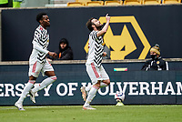 23rd May 2021; Molineux Stadium, Wolverhampton, West Midlands, England; English Premier League Football, Wolverhampton Wanderers versus Manchester United; Juan Mata of Manchester United celebrates after scoring a penalty in the last minute of the first half for 2-1 lead