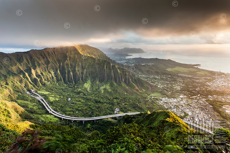 """An aerial view at dawn of the Ko'olau Range and H-3 Highway in Ha'iku Valley from Haiku Stairs (""""Stairway to Heaven"""") hiking trail in Kane'ohe, O'ahu."""