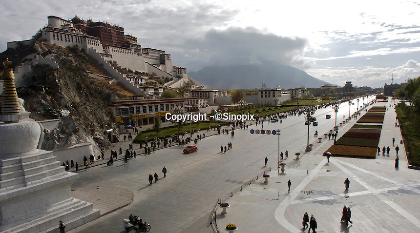 The Potala Palace and the Potala Palace Square. Lhasa, Tibet Autonomous Region, China. Despite the reopening for Chinese tourists on May 1 after the March 14 riots, most of the Monasteries are closed, such as the Jokhang Monastery in the Bakuo Street area, all touristic spots in Bakuo Street are blocked off from non Tibetan residents entry and under heavy surveillance by army and plain clothed agents..04 May 2008