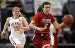 Liberty's Celine Quintino runs from Manogue defender Tawni Henderson during the NIAA Division I state basketball tournament in Reno, Nev. on Thursday, Feb. 25, 2016. Liberty won 59-53. Cathleen Allison/Las Vegas Review-Journal