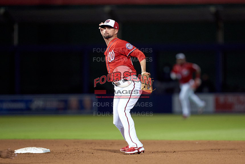 Washington Nationals second baseman Jordy Mercer (27) throws to first base during a Major League Spring Training game against the Miami Marlins on March 20, 2021 at FITTEAM Ballpark of the Palm Beaches in Palm Beach, Florida.  (Mike Janes/Four Seam Images)