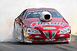 Ronnie Humphrey (2062) driver for the Genuine Hot Rod Hardware teammakes a pass during the O'Reilly Auto Parts Spring Nationals at the Royal Purple Raceway in Baytown,Texas.