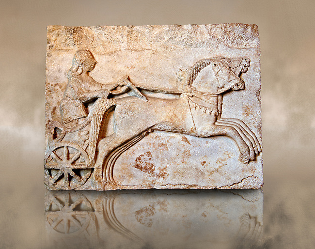 Late  Greek Archaic relief sculpture in Proconnesian Marble of a charioteer ( Last quarter 6th Cent. B.C) From Cyzicus, ( Erdek formerly Artàke, Αρτάκη in Greek) on the southern shore of the sea of Marmara, Turkey. Istanbul Archaeological Museum Inv. 2813T Cat. Bursa M.1.