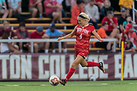 NEWTON, MA - AUGUST 29: Chloee Sagmoe #4 of Boston University passes the ball during a game between Boston University and Boston College at Newton Campus Field on August 29, 2019 in Newton, Massachusetts.