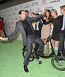 Matthew Rhys rides an electric bike infront of the cast of REVENGE attends The 21st Annual Environmental Media Awards held at at Warner Bros. Studios in Burbank, California on October 15,2011                                                                               © 2011 DVS / Hollywood Press Agency