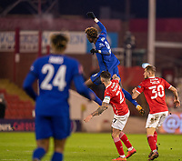 11th February 2021; Oakwell Stadium, Barnsley, Yorkshire, England; English FA Cup 5th round Football, Barnsley FC versus Chelsea; Tammy Abraham of Chelsea jumps high above Alex Mowatt of Barnsley to win a clearing ball