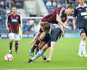 Raith Rovers' Colin Wilson takes out Hearts' Dylan McGowan