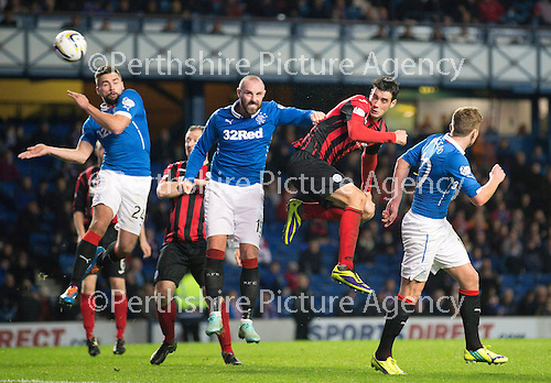 Rangers v St Johnstone....28.10.14   Scottish League Cup Quarter Final at Ibrox<br /> Brian Graham heads wide<br /> Picture by Graeme Hart.<br /> Copyright Perthshire Picture Agency<br /> Tel: 01738 623350  Mobile: 07990 594431