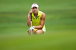 CHON BURI, THAILAND - FEBRUARY 17:  Lexi Thompson of USA lines up a putt on the 9th green during day two of the LPGA Thailand at Siam Country Club on February 17, 2012 in Chon Buri, Thailand.  Photo by Victor Fraile / The Power of Sport Images