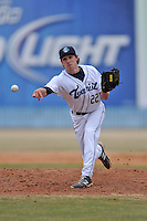 Asheville Tourists pitcher Trent Blank #22 delivers a pitch during a game against the  Delmarva Shorebirds at McCormick Field on April 6, 2014 in Asheville, North Carolina. The Shorebirds defeated the Tourists 4-2. (Tony Farlow/Four Seam Images)