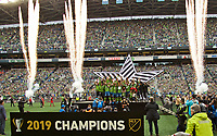 SEATTLE, WA - NOVEMBER 10: The Seattle Sounders celebrate with the MLS Cup during a game between Toronto FC and Seattle Sounders FC at CenturyLink Field on November 10, 2019 in Seattle, Washington.