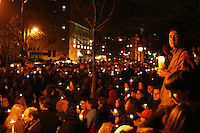 Thousands gather outside of New York Senator Charles Schumer's penthouse apartment on March 16, 2003 to protest his stance in supporting the invasion of Iraq.