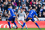 Daniel Carvajal Ramos (C) of Real Madrid competes for the ball with Ruben Duarte (L) and Ruben Sobrino Pozuelo of Deportivo Alaves during the La Liga 2017-18 match between Real Madrid and Deportivo Alaves at Santiago Bernabeu Stadium on February 24 2018 in Madrid, Spain. Photo by Diego Souto / Power Sport Images