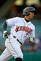 Indianapolis Indians left fielder Chris Bostick (7) runs to first base during a game against the Toledo Mud Hens on May 2, 2017 at Victory Field in Indianapolis, Indiana.  Indianapolis defeated Toledo 9-2.  (Mike Janes/Four Seam Images)