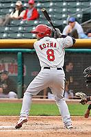 Pete Kozma (8) of the Memphis Redbirds at bat against the Salt Lake Bees at Smith's Ballpark on June 18, 2014 in Salt Lake City, Utah.  (Stephen Smith/Four Seam Images)