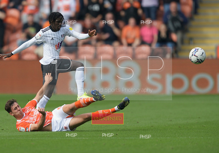 11/09/2021 Sky Bet Championship Blackpool v Fulham<br /> <br /> Ryan Wintle tackles Domingos Quina