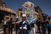 "Group of miners carry their Tata Kajchu (Saint of the mine) to the Cathedral to be blessed, in this case a statue of the Virgin Mary. Potosi, Bolivia. 23 January 2016. With this blessing, they begin the festivities of the Miners Carnival./ Grupo de mineros llevan a su Tata Kajchu (santo de la mina) a la catedral para su correspondiente bendición, en este caso una estatua de la Virgen María. Potosí, Bolivia. Enero 23 de 2016. Con esta bendicion empiezan las fiestas del Carnaval Minero. The customs and beliefs of Andean people are a hybrid of catholic religion and old beliefs. One of its highest expressions is within the Bolivian mining culture that worships the Pacha Mama (Mother Earth), the Celestial Divinity personified in the Catholic God and ""El Tio"" of the mine (Satan). To the latter, who rules the underworld, they make offerings with sacrifices of llamas inside the mines to ask for protection in the depths of the mountain and abundant mineral."