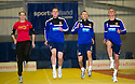 Scots Athlete Eilidh Child takes Hearts' players Jack Hamilton, Dale Carrick, and Kevin McHattie through their paces at Grangemouth Stadium.