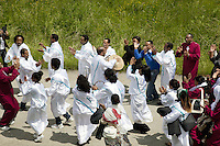 Switzerland. Canton Valais. St-Maurice. Africa Saints Pilgrimage (Pèlerinage aux Saints d'Afrique). Religious <br /> procession. The people, dressed in white, are originally from Eritrea. They walk in front of the procession and dance following the tempo of a drum.The procession goes from Véroliez  a quarter of St-Maurice to St-Maurice's abbey.  2.06.13 © 2013 Didier Ruef