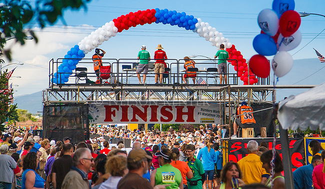 runners and spectators at the missoula marathon finish line in downtown missoula montana