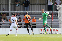 Chris Kettings of Crystal Palace (right) saves a shot from John Akinde of Barnet (centre) during the Friendly match between Barnet and Crystal Palace at The Hive, London, England on 11 July 2015. Photo by David Horn.