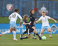Sonia Bompastor (8) of the Washington Freedom slips the ball between Carli Lloyd (10) and Ella Masar (3) of the Chicago Red Stars during a WPS match at Maryland Soccerplex on April 11 2009, in Boyd's, Maryland.  The game ended in a 1-1 tie.
