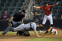 "Luis Gonzalez (6) of the Kannapolis Intimidators slides head first across home plate ahead of the tag by West Virginia Power catcher Arden Pabst (25) as home plate umpire Jude Koury looks on and Aaron Schnurbusch (21) makes a ""safe"" sign at Kannapolis Intimidators Stadium on July 19, 2017 in Kannapolis, North Carolina.  The Power defeated the Intimidators 7-4 in 11 innings.  (Brian Westerholt/Four Seam Images)"