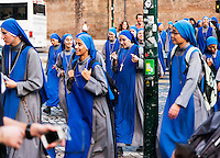 Group of young nuns of the Servants of the Lord religious order explore the sights of ancient Rome, Italy