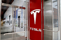 NEW YORK - NEW YORK - MARCH 24: The Tesla logo is seen at its store in Lower Manhattan on March 24, 2021 in New York. Tesla Inc said it bought $1.5 billion worth of bitcoin and would soon accept it as a form of payment for its cars. (Photo by John Smith/VIEWpress)