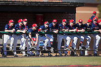 The Shippensburg Raiders line-up in the visitors dugout prior to the game against the Belmont Abbey Crusaders at Abbey Yard on February 8, 2015 in Belmont, North Carolina.  The Raiders defeated the Crusaders 14-0.  (Brian Westerholt/Four Seam Images)