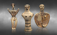 Mycenaean female figurines  from Mycenae tombs, Archaeological Museum Athens.  Grey art Background <br /> <br /> Left: Seated Mycenaean female figurine with raies arms, from Mycenae tomb 91,  Cat No 3193. <br /> <br /> Middle: Hollow Mycenaean female figurine, adorant, wearing a necklace, from Mycenae tomb 40,  Cat No 2494. <br /> <br /> Right: Upper part of a Mycenaean female figurine with stylised arms wearing a necklace, from Mycenae tomb 101,  Cat No 4690