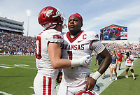 Arkansas linebacker Bumper Pool (10) consoles Arkansas quarterback KJ Jefferson (1), Saturday, October 9, 2021 at the end of a football game at Vaught Hemingway Stadium in Oxford, Miss. Check out nwaonline.com/211010Daily/ for today's photo gallery. <br /> (NWA Democrat-Gazette/Charlie Kaijo)