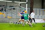 St Brendan's Padraig O'Sullivan clears a ball from the St Brendan's defence as Crotta's Declan O'Donoghue bares down on his effort in the County Senior Hurling Championship quarter final