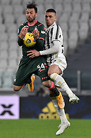 Samuel Di Carmine of FC Crotone and Merih Demiral of Juventus FC compete for the ball during the Serie A football match between Juventus FC and FC Crotone at Allianz stadium in Torino (Italy), February 22th, 2021. Photo Giuliano Marchisciano / Insidefoto