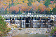 A dam on the Saco River at the Willey House Historical Site in Hart's Location in the New Hampshire White Mountains during the autumn months. The Willey House Historical site is within the scenic Crawford Notch State Park.
