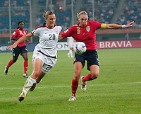 U.S. forward Abby Wambach (20) fights off England defender Faye White (5). The United States (USA) defeated England (ENG) 3-0 during a quarter-final match of the FIFA Women's World Cup China 2007 at Tianjin Olympics Center Stadium in Tianjin, China, on September 22, 2007.
