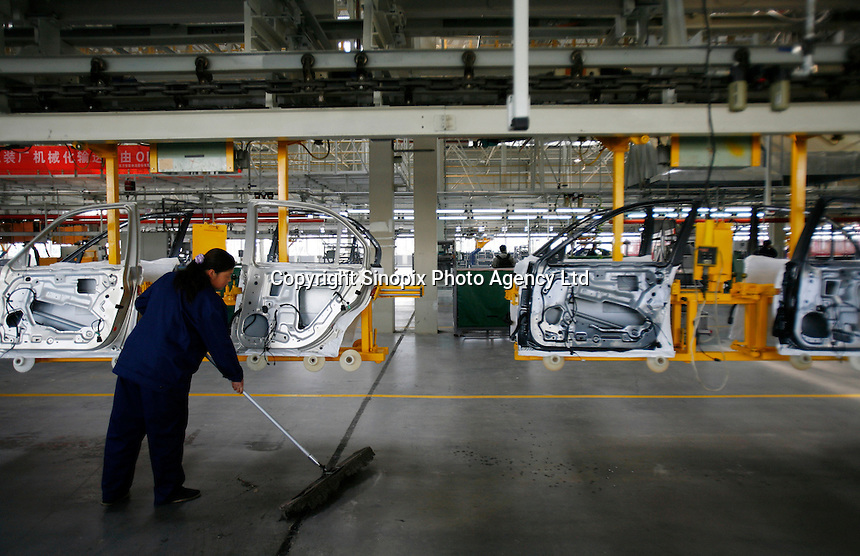 A Chinese worker sweeps the floor at the Nanjing MG Automibile Corporation plant in Nanjing, China. The Chinese company is now in a position to take on Rover's assets and plan its future. It intended to relocate the engine plant and some car production plant to China but to retain some car production plant in the UK..27 Mar 2007