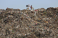 Workers collect and sort through garbage at the Dhapa landfill in the west of Kolkata.<br /> <br /> To license this image, please contact the National Geographic Creative Collection:<br /> <br /> Image ID: 1925729 <br />  <br /> Email: natgeocreative@ngs.org<br /> <br /> Telephone: 202 857 7537 / Toll Free 800 434 2244<br /> <br /> National Geographic Creative<br /> 1145 17th St NW, Washington DC 20036