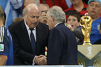 FIFA President Sepp Blatter and Argentina manager Alejandro Sabella shake hands near the World Cup trophy
