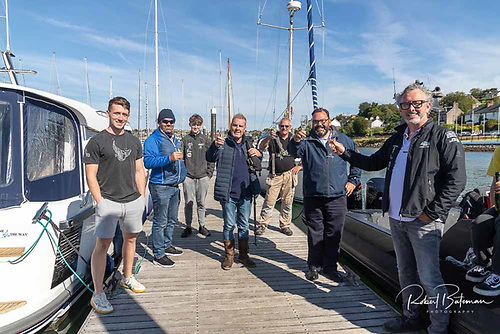 Record breakers - celebrating at Royal Cork Yacht Club marina after the record time was set, John Ryan (right)and Colin Morehead  (second from right) and the Zerodark team