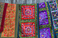Longji, China.  Colorful Embroidered Fabric Designs.